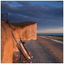 slides/Cliffside Mooring.jpg coast guard cottages east sussex coastal coast blue sky winter seaside cold bitter panoramic cliffs white seven sisters country park cuckmere haven beach storm rough sea sunset Cliffside Mooring