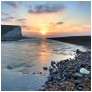 slides/Dawn over Cuckmere River.jpg sussex east birling.gap beach pools tide ocean coast beachy head lighthouse eastbourne rocks water ocean people person clouds storm cliffs pebbles red white blue seven sisters country park moon cresent ripples sand Dawn over Cuckmere River